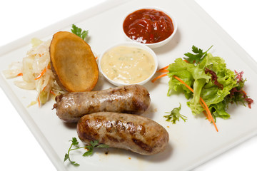 German sausages with roasted potatoes and sauerkraut.