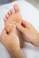 Close up of physiotherapist giving a patient a foot massage