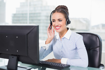 Smiling businesswoman using headset