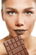 young fresh beautiful woman eating chocolate, beauty female face