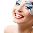 young woman with beautiful water makeup smiling over white