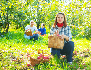 family with  harvested apples