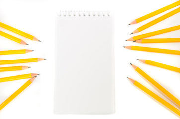 Notebook and pencils with isolated white background
