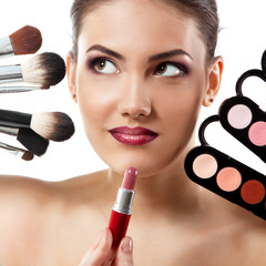 beauty portrait of young beautiful woman with makeup brushes, li