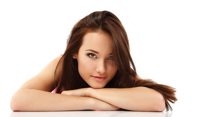 young woman beautiful cheerful lying and looking at camera isola