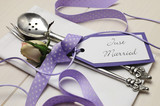Purple polka dot wedding table place setting. Close up.