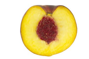 Peach with kernel cut through