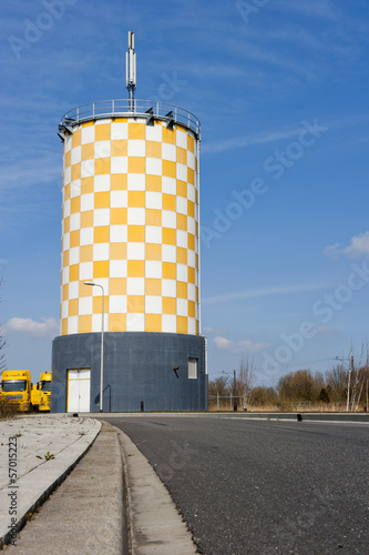 Modern yellow white chequered watertower