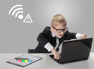 Angry boy with laptop. No wireless connection available
