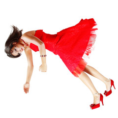 beatiful woman broken doll falling down in red dress isolated on