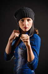Young beautiful woman ready to fight