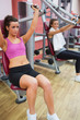Weights machines being used by women