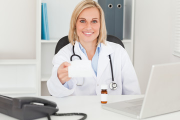 Doctor holding prescription