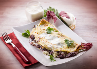 crepes with chicory and cheese, selective focus
