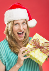 Surprised Woman Holding Christmas Present
