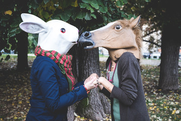 horse and rabbit mask women in the park