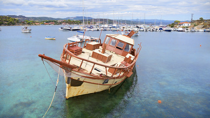Aerial view of a wooden boat in the sea in Chalkidiki