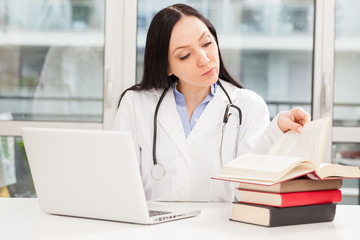 Female doctor is studying with books