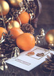Christmas Card with Christmas decoration, oranges and pine cones