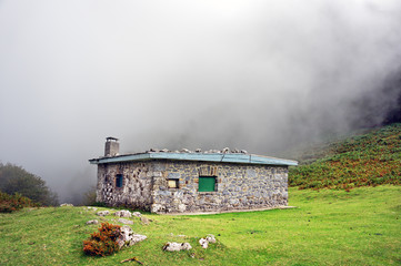 shelter in the mountain with fog