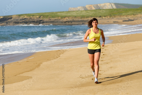 Woman running on sand beach