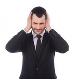 Annoyed businessman covering his ears with his hands