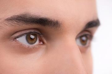 Macro shot of a man eyes. Isolated on white background