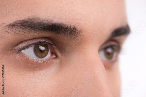 Macro shot of a man eyes. Isolated on white background