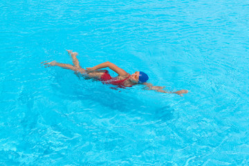 Woman swims freestyle in the pool