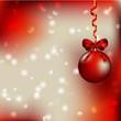 рождественский фон с красным елочным шаром и ленточкой