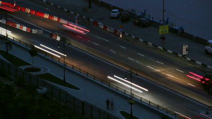 Night road timelapse cars move leave long traces, lights on