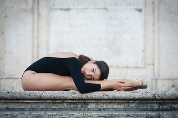 Young beautiful ballerina dancing on the Spanish Steps in Rome,