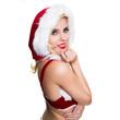 attraktive blonde Weihnachtsfrau blickt über Schulter