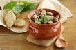 mushroom ragout of champignons and basil on a wooden table