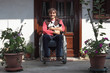man in wheelchair with a cat