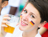 German Supporter Drinking Beer at Stadium
