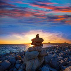 Ibiza Cap des Falco beach sunset with desire stones
