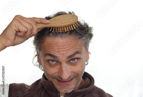 man with hair brush