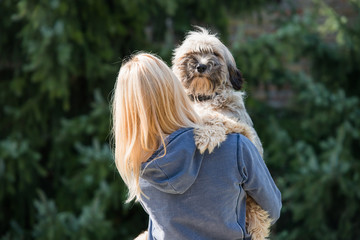 girl holding her dog in arms