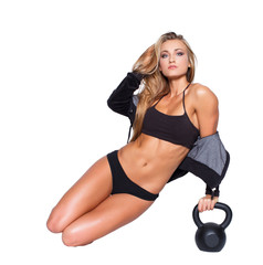 Sexy fitness model sit with kettlebell