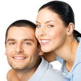 Young happy smiling couple, isolated over white