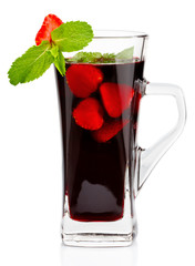 Glass of hot fruit tea with fresh mint and strawberry isolated