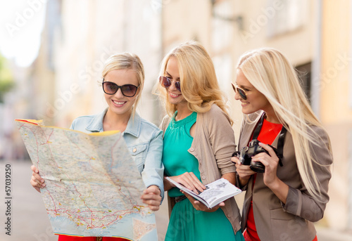 beautiful women with tourist map in the city