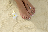 Woman's feet in the sand