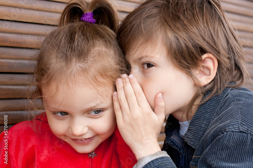 two kids sharing secret