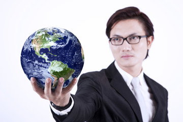 Businessman giving globe - isolated