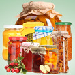 Set of canned vegetables and fruits on green background