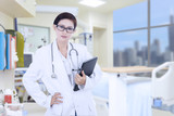 Confident female doctor at hospital