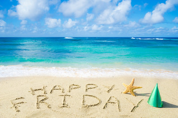 "Sign ""Happy Friday"" on the sandy beach"