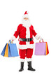 Full length portrait of a Santa Claus holding shopping bags